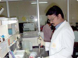 A man in a laboratory using a pipette